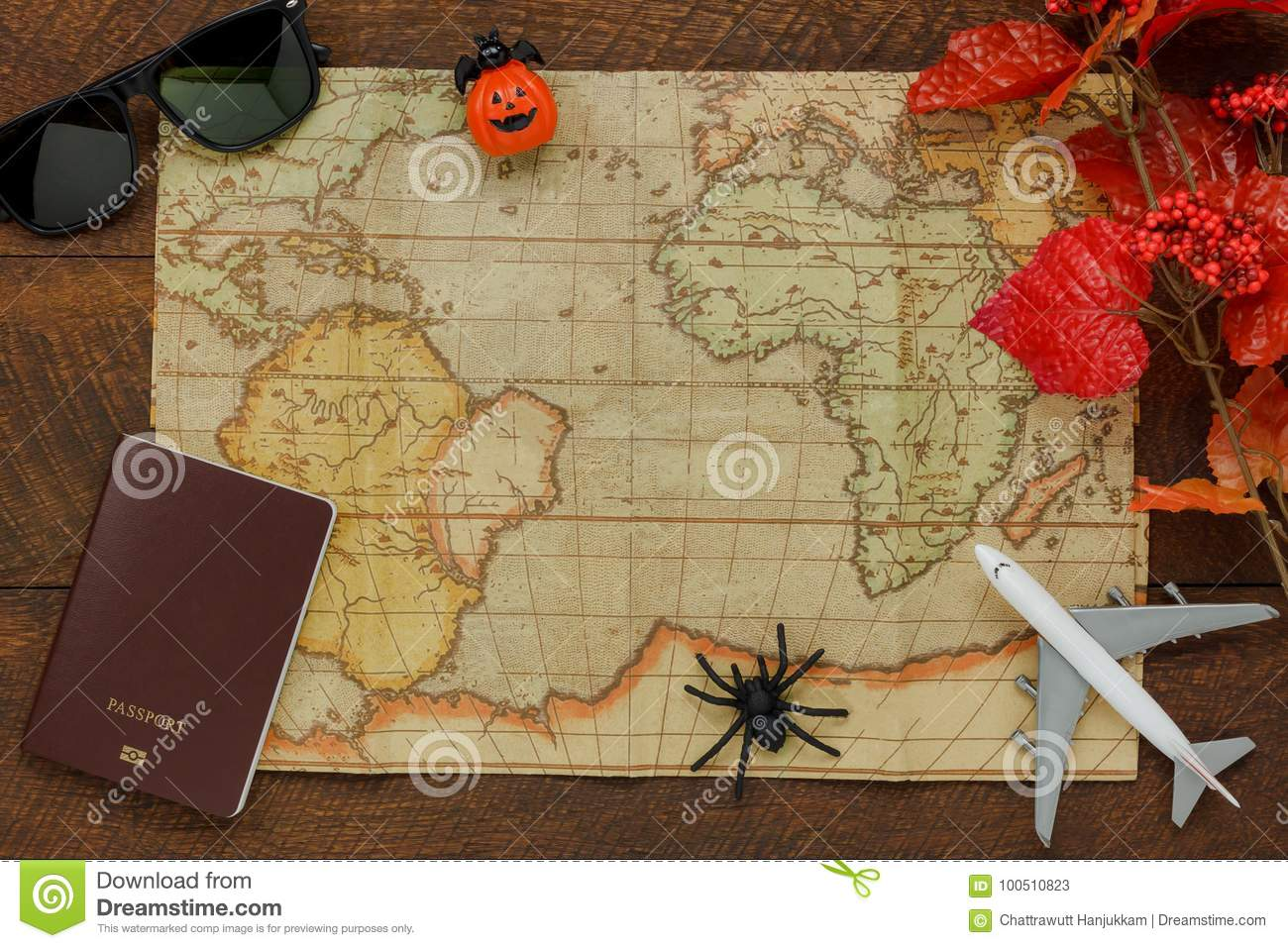 Above view of accessory Happy Halloween with items to travel background
