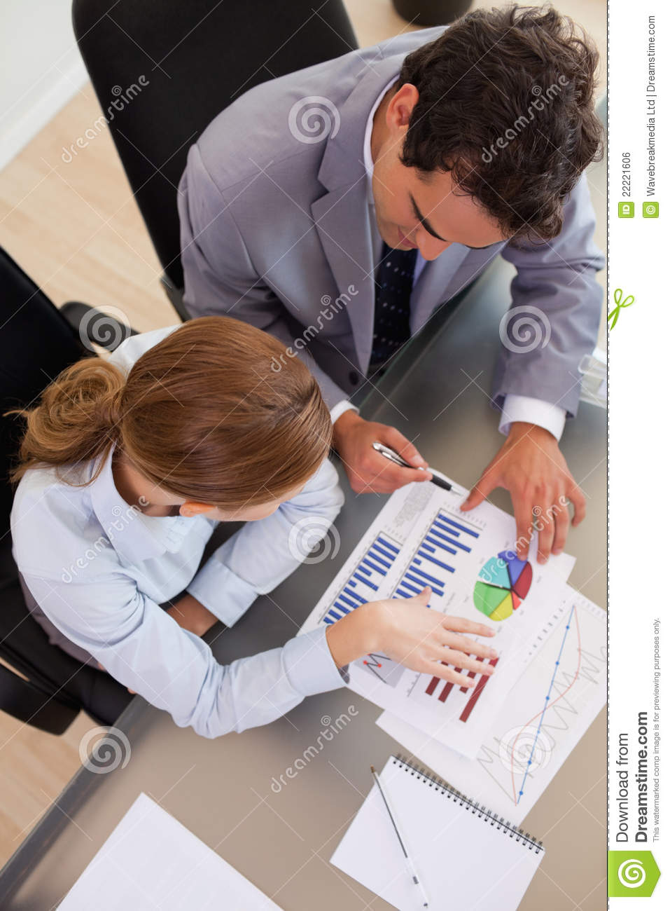 above view of business people analyzing data royalty free