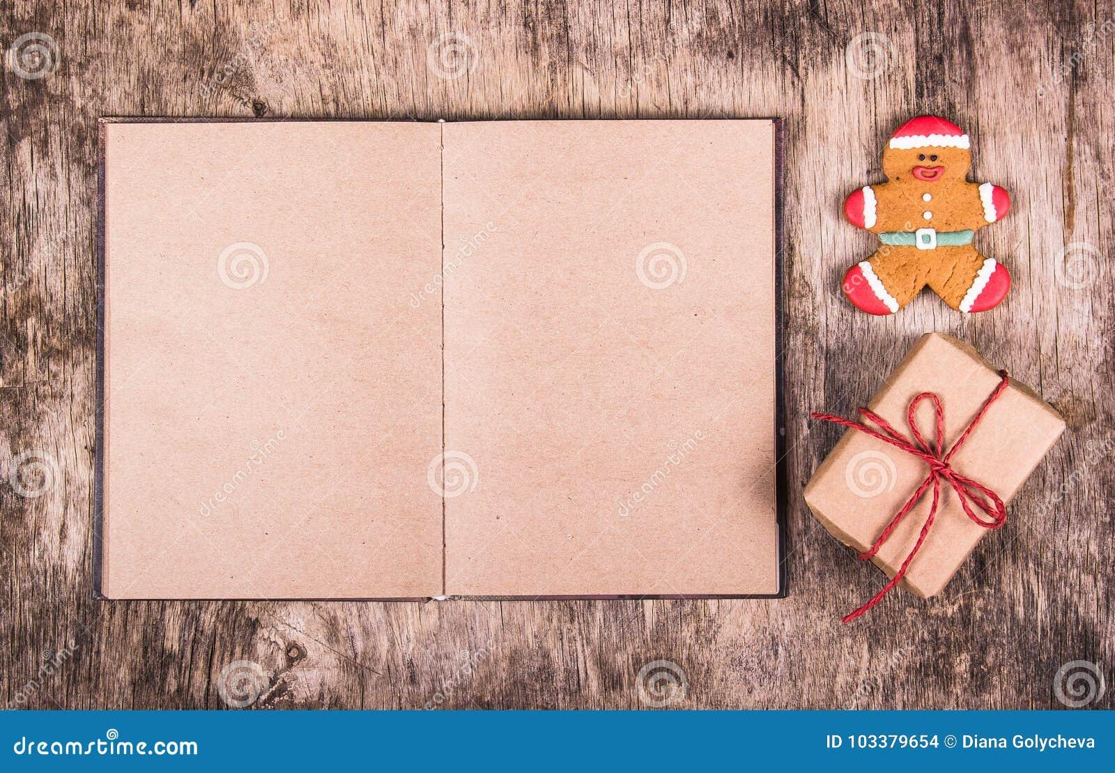 Abra la caja del libro, del hombre de pan de jengibre y de regalo Sorpresa de la Navidad Fondos festivos