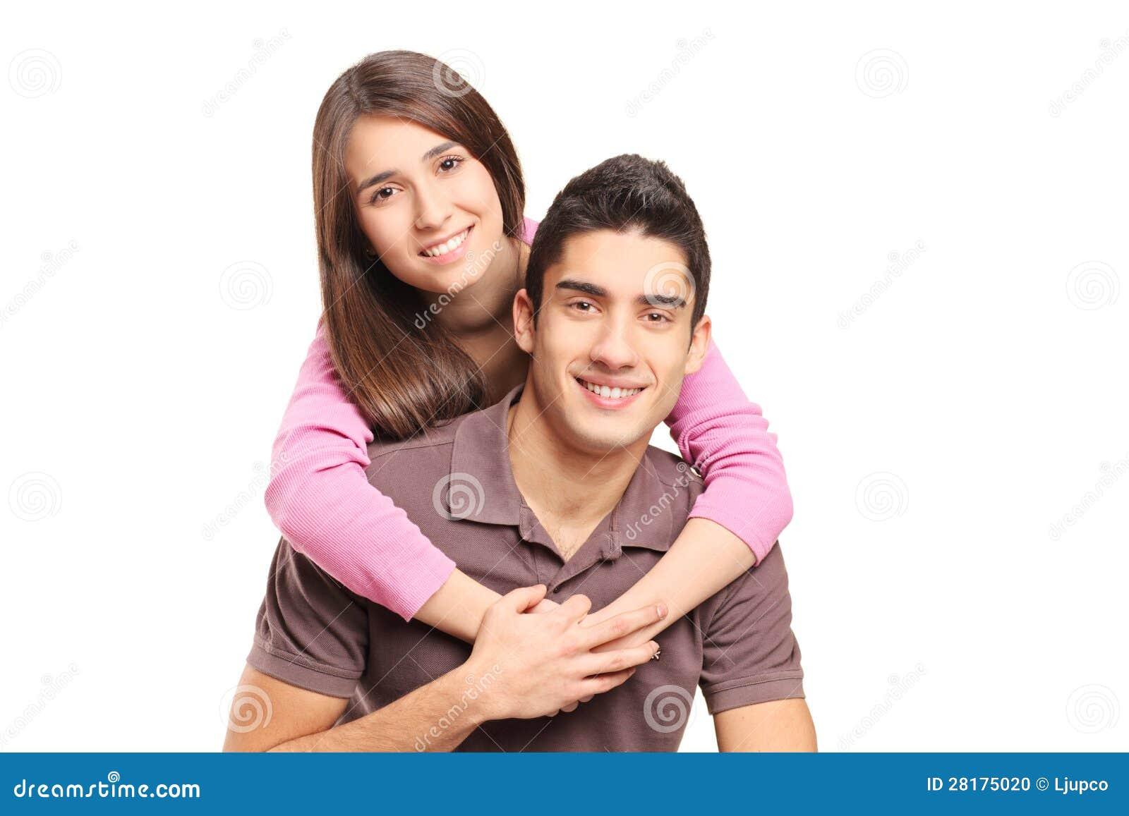 Abrazo cariñoso joven de los pares