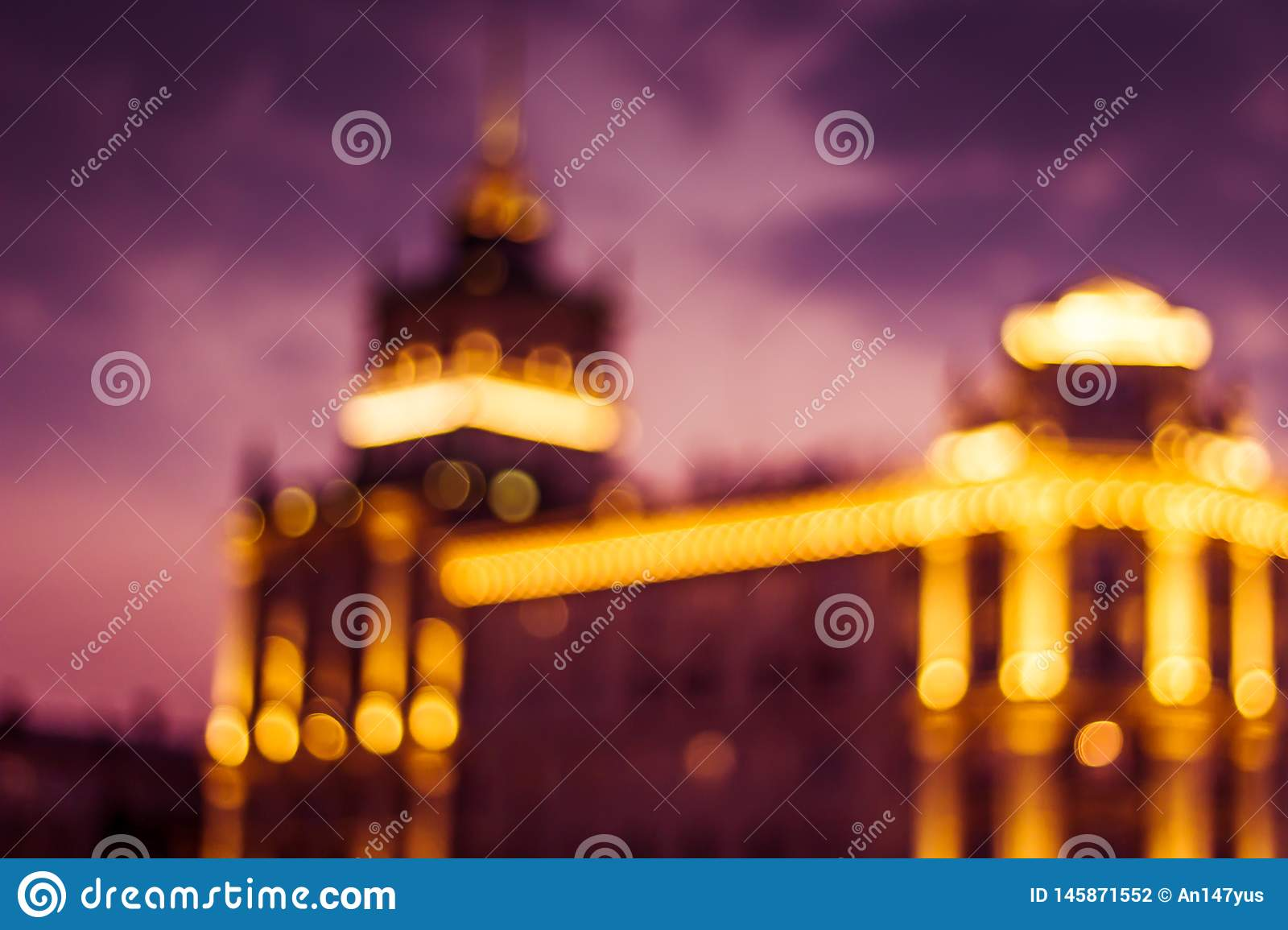 Abstract artistic photo: blurry cityscape with streetlights