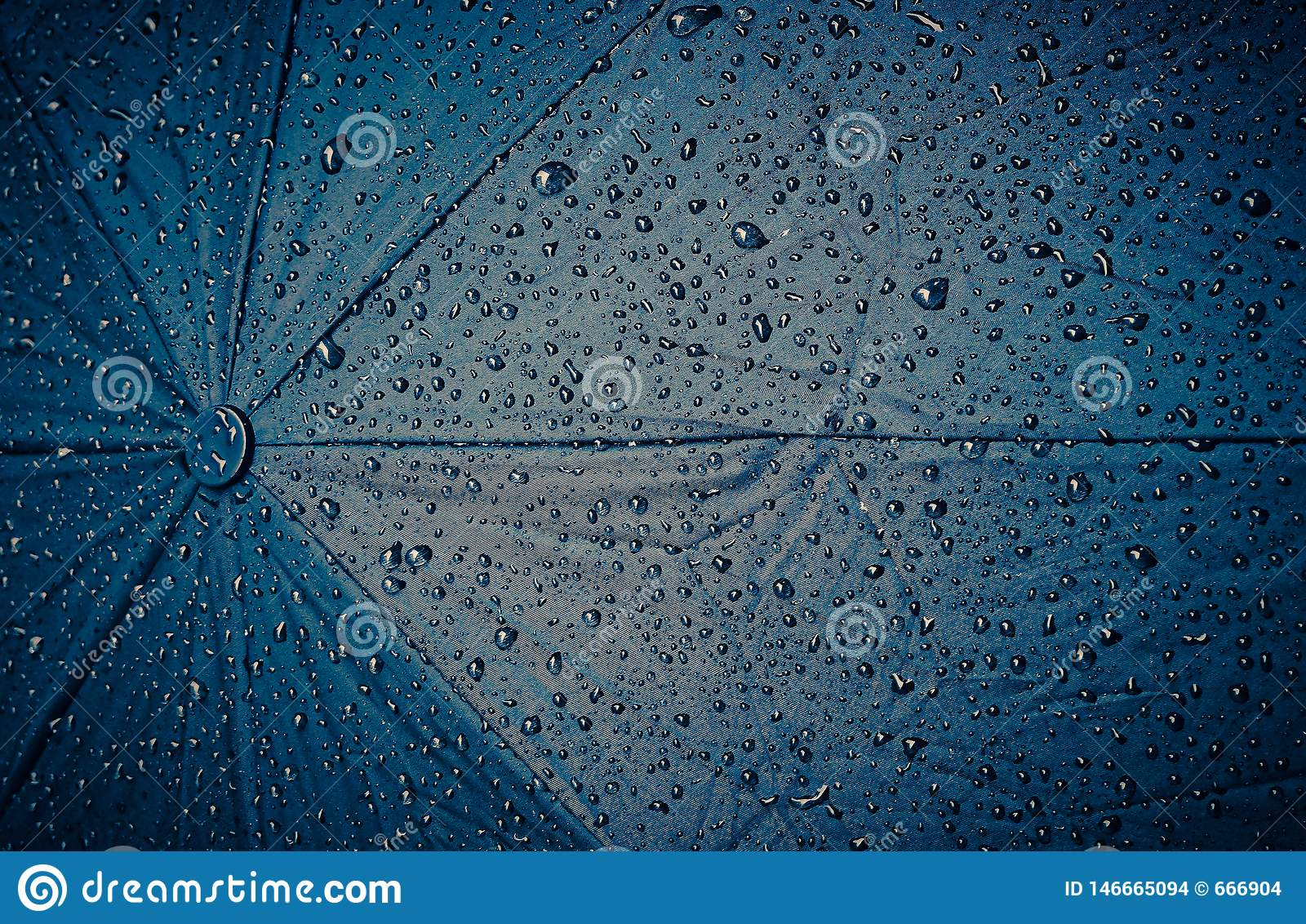 Abstract background, blue umbrella with raindrops