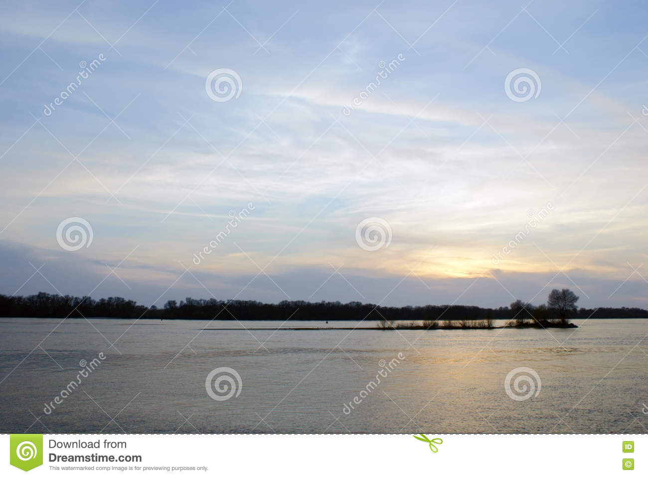 Abstract background of blue sky with clouds at sunset over the river