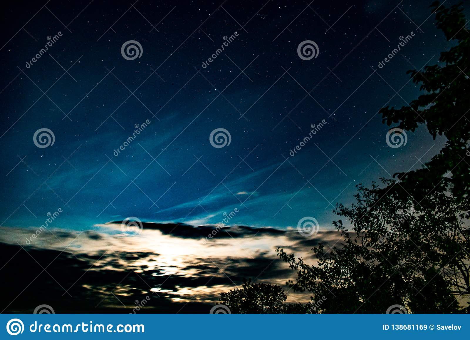 Background with clouds, stars and the light of the rising sun