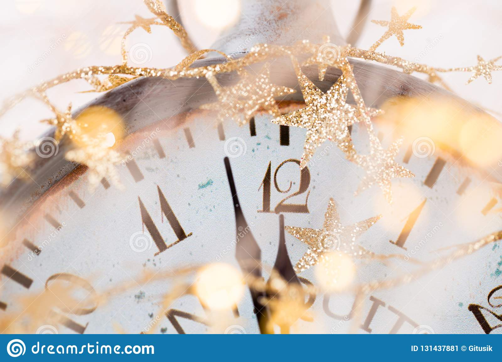 Abstract background with fireworks and clock close to midnight. Christmas and happy new years eve background