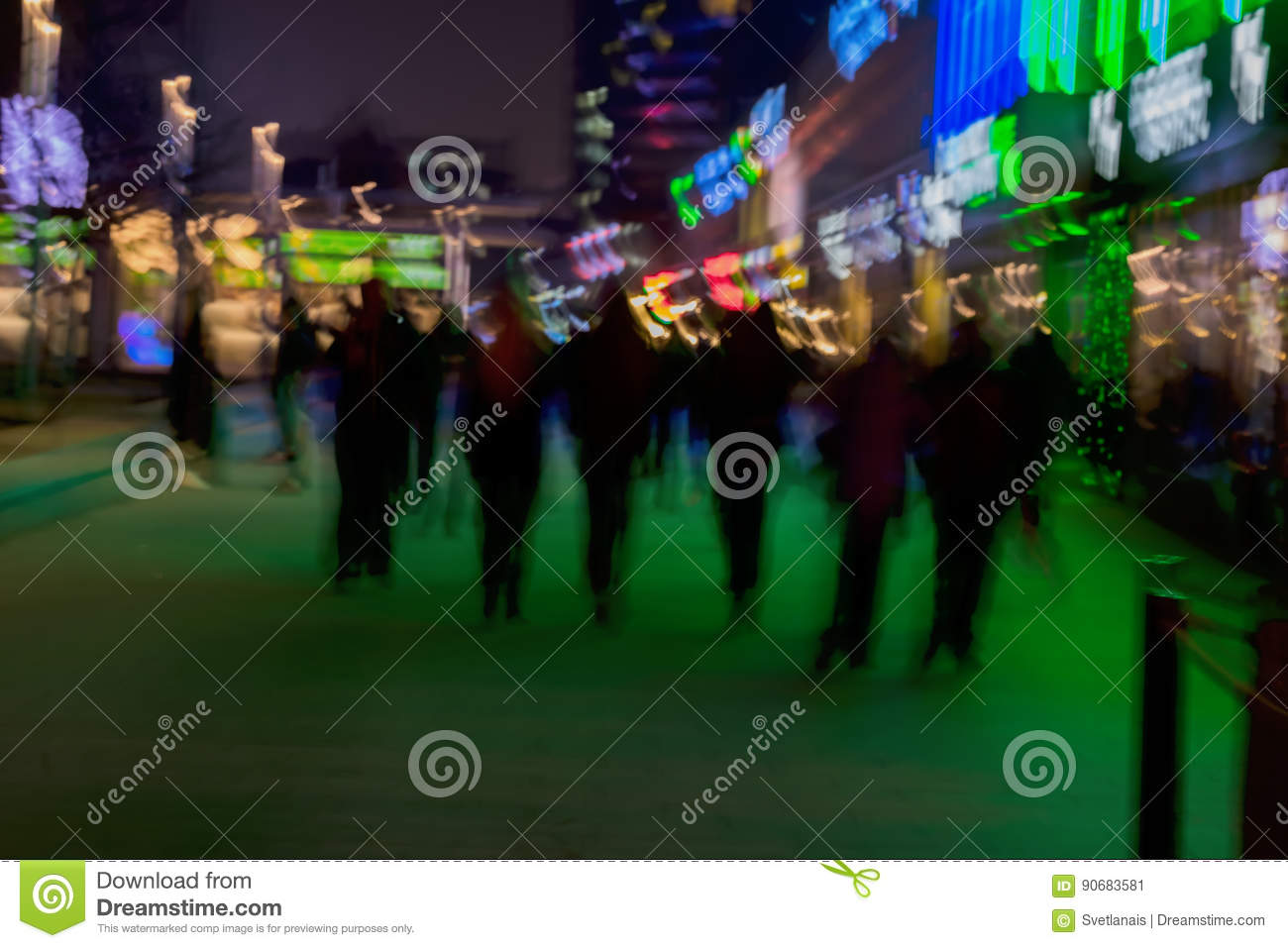 Abstract background. Intentional motion blur. Group of young people going along the street. Green shop window