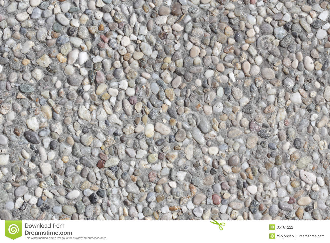Abstract background paving consisting of small pebbles embedded in ...