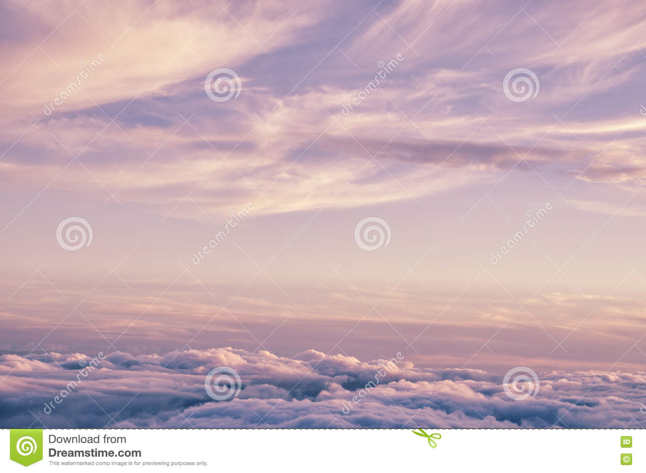 Abstract background with pink, purple and blue colors clouds. Sunset sky above the clouds.