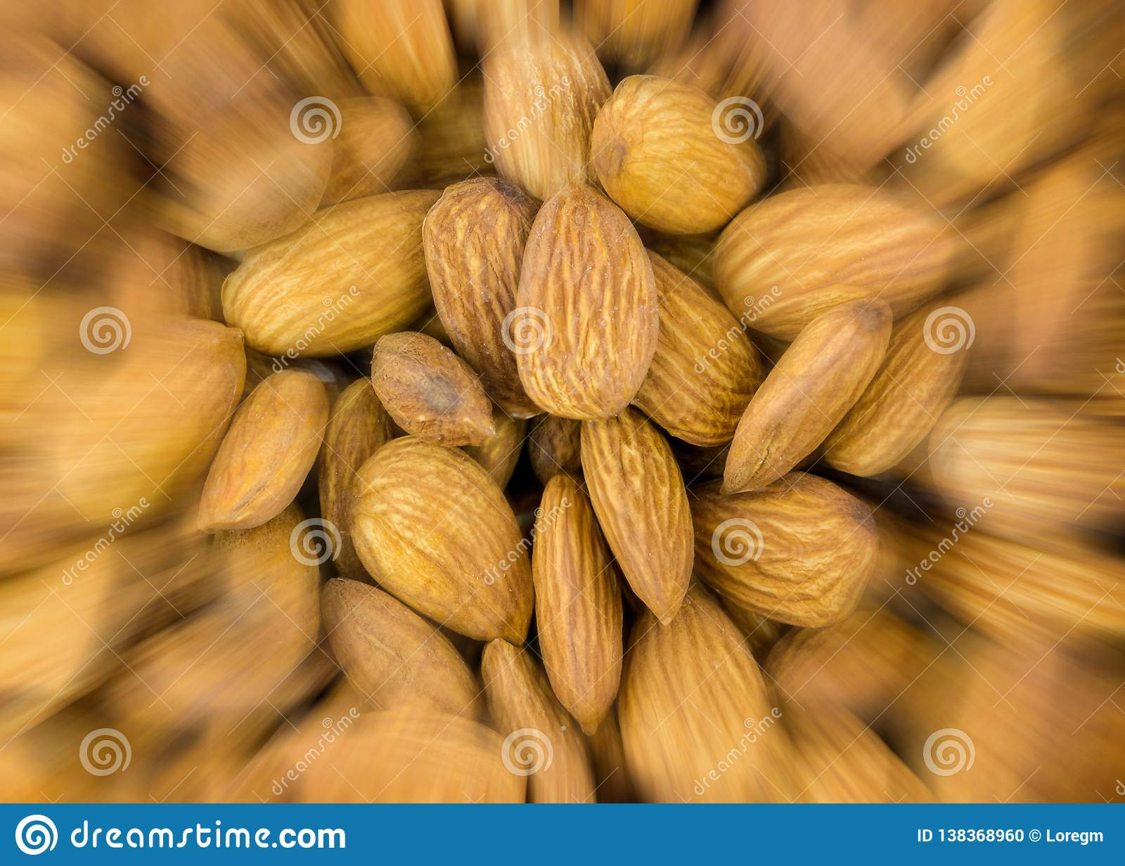 Abstract background speed blur acceleration nut almond culinary pattern closeup brown delicious snack