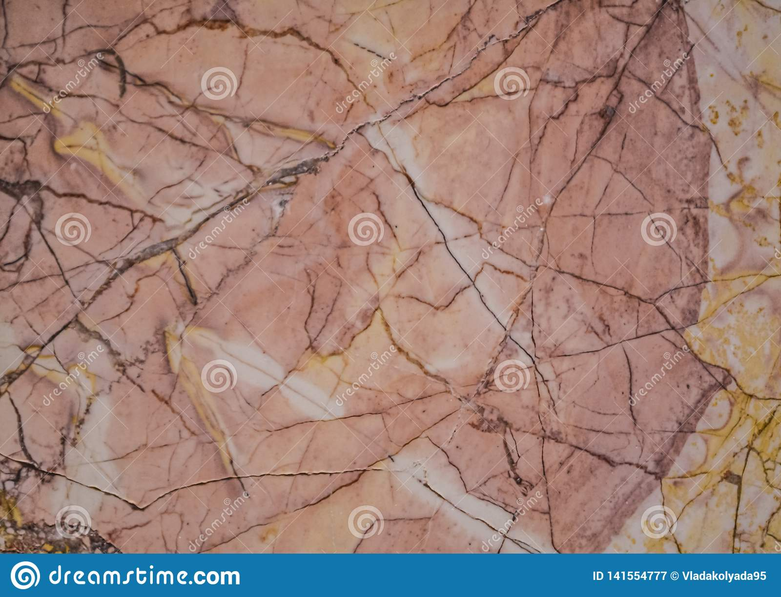 Abstract background or texture from a stone in a section, a pink and gray shade with spots, cracks and stains. Solid material.