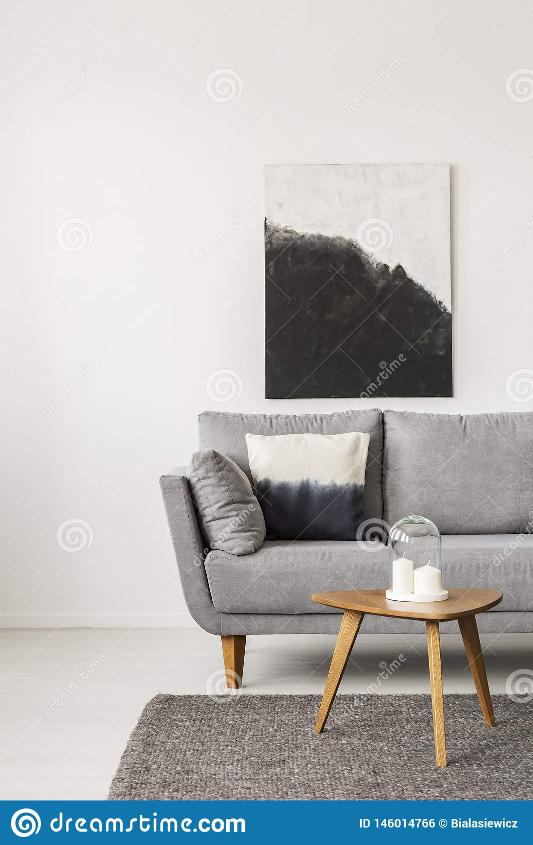 Black And White Painting On Empty White Wall With Wooden