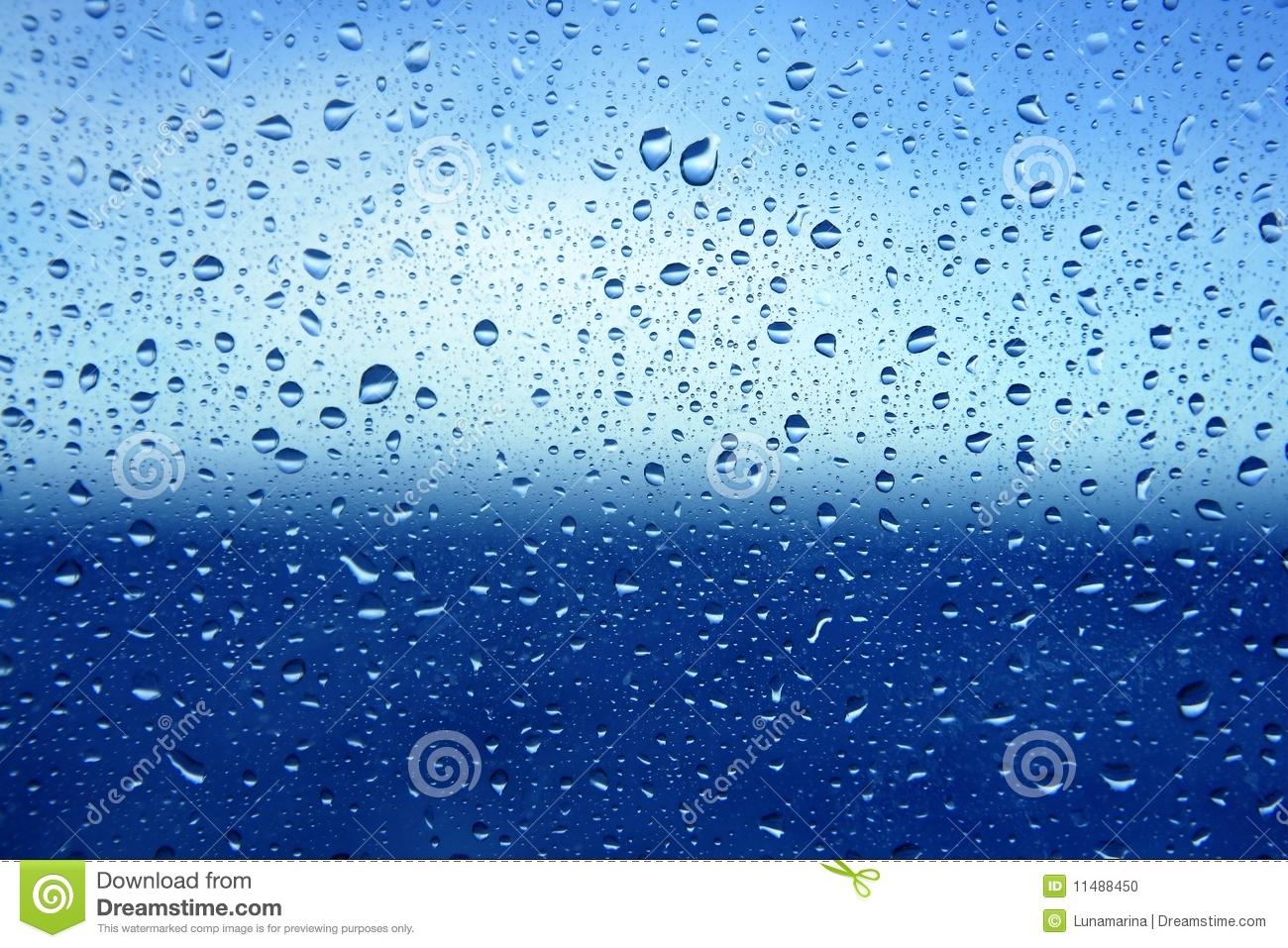 Abstract blue water dropsoin glass background