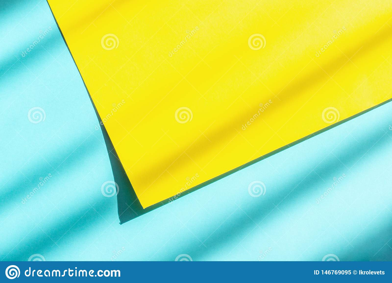 Abstract blue and yellow paper background with hard light and shadow for your design