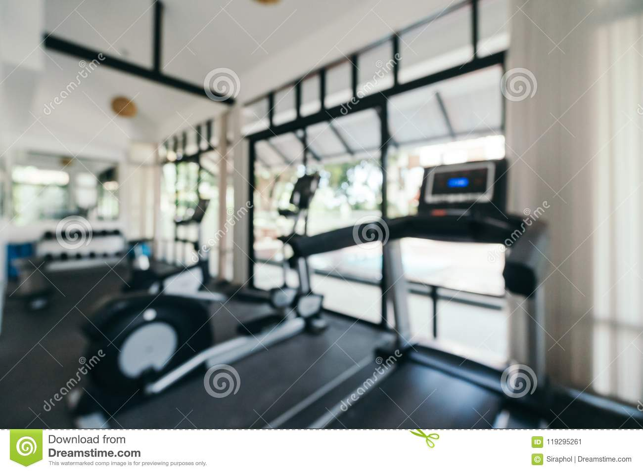 Abstract blur and defocused fitness equipment interior of gym room