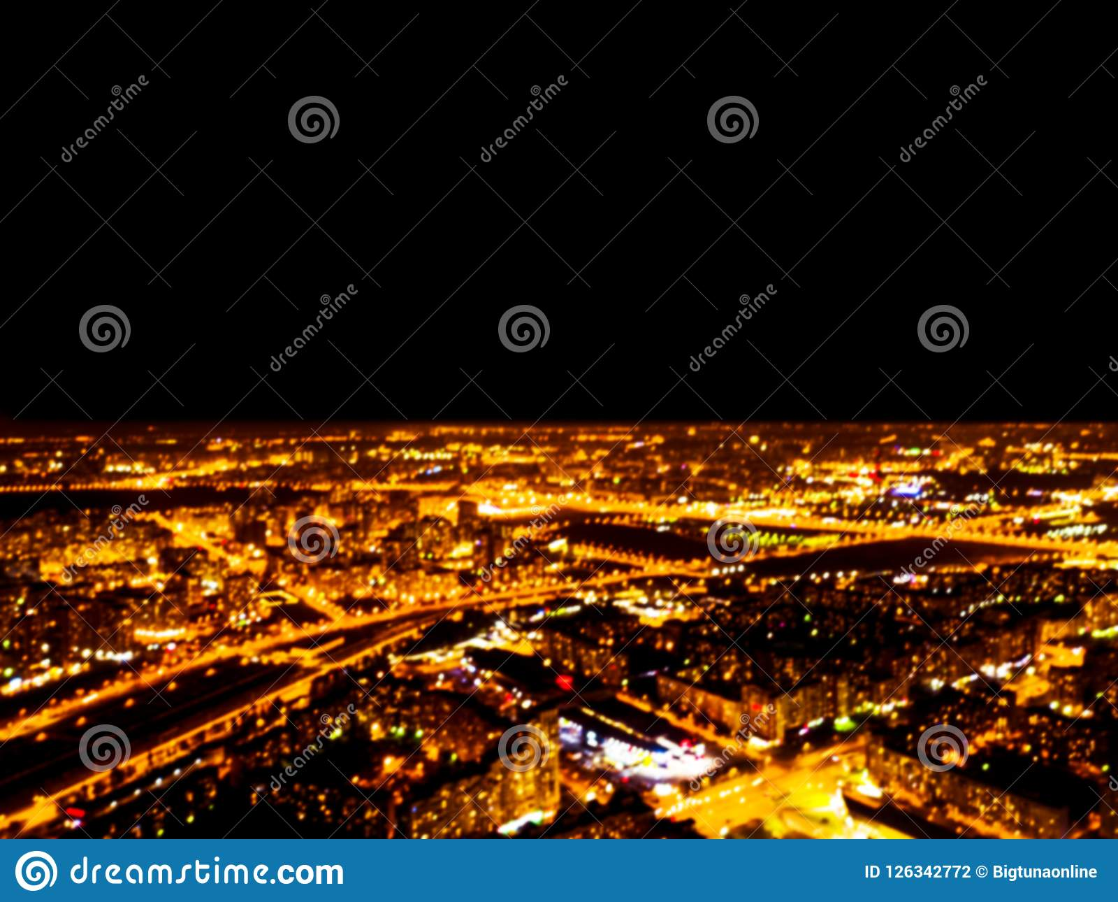 Abstract Blurred background Aerial night view of a big city. Cityscape panorama bokeh at night. Blurry Aerial view of skyscraper a