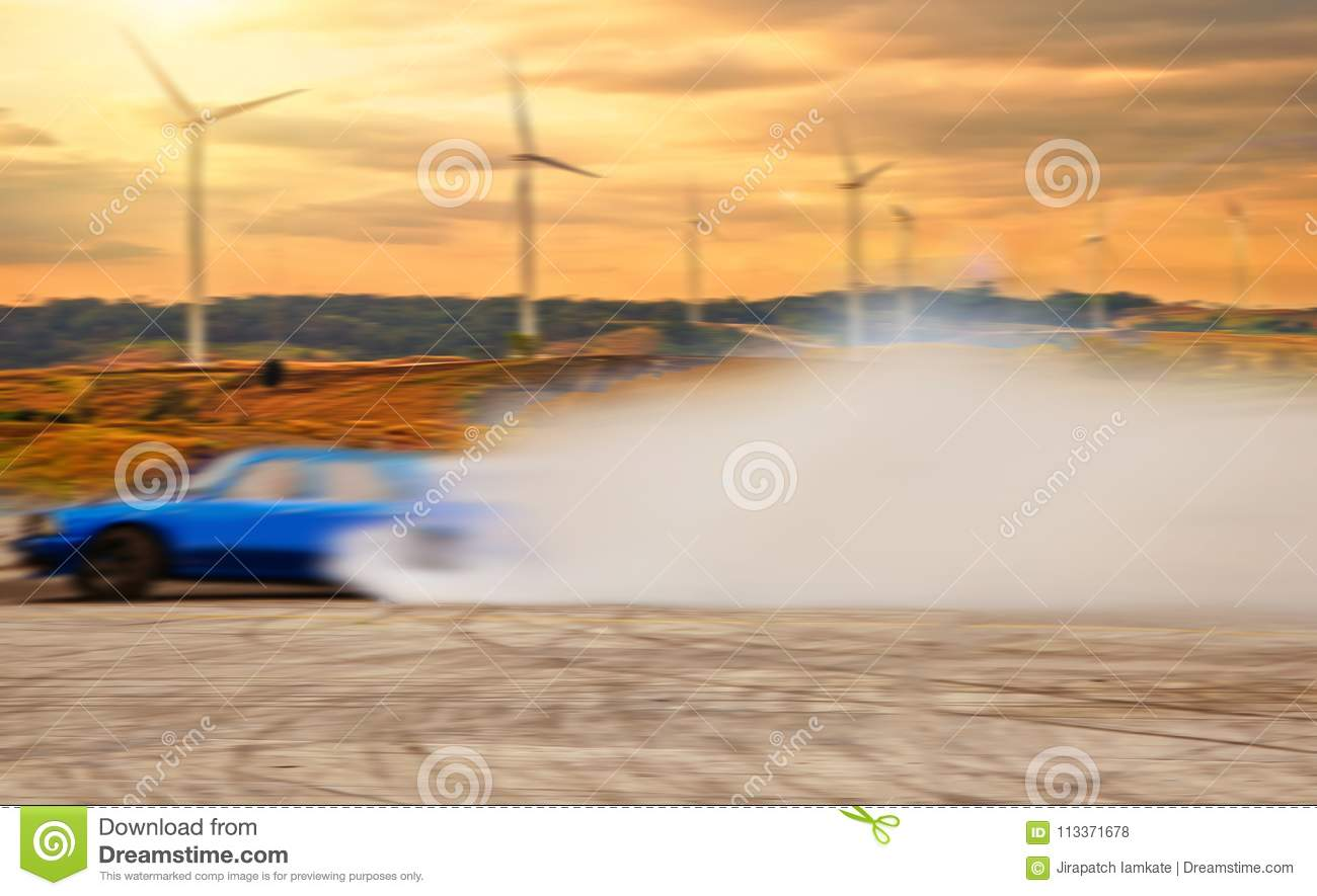 Abstract blurred drift car with smoke from burned tire at wind t