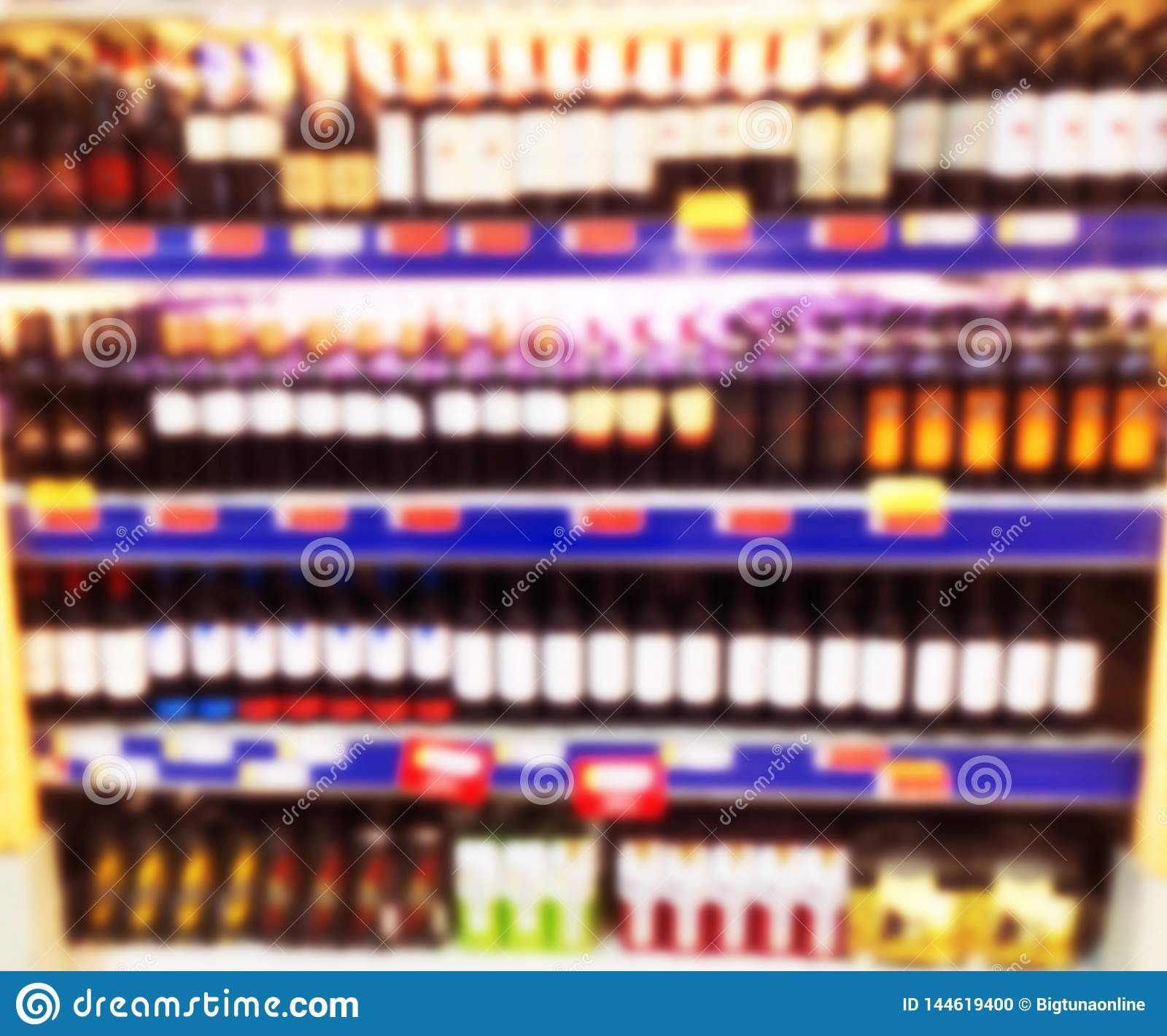 Abstract blurred supermarket store and refrigerators in department store. Interior shopping mall defocused background. Business fo