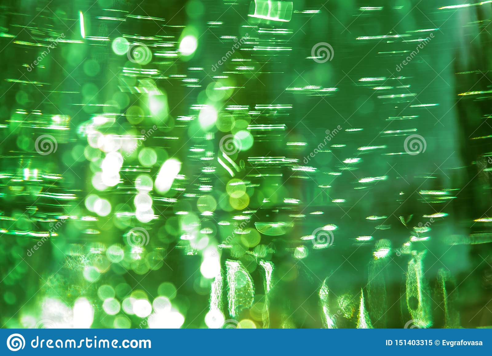 Abstract bright defocused ultra green color shiny background with water texture with bubbles with bokeh effect