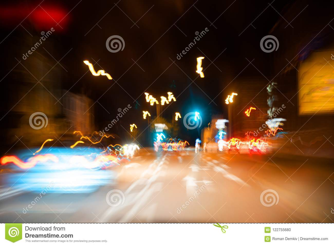 Abstract colorful background, car at speed, light traffic lights, pointers and signs, nightlife in metropolis