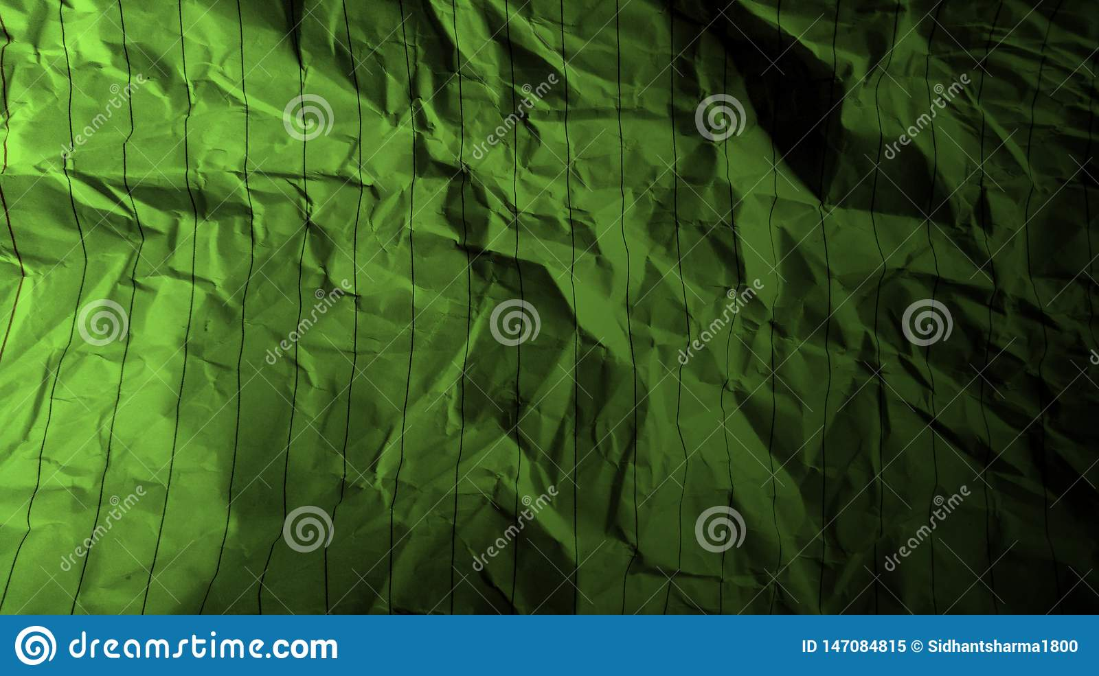 Abstract crumpled paper black avocado green color mixture multi colors effects background.