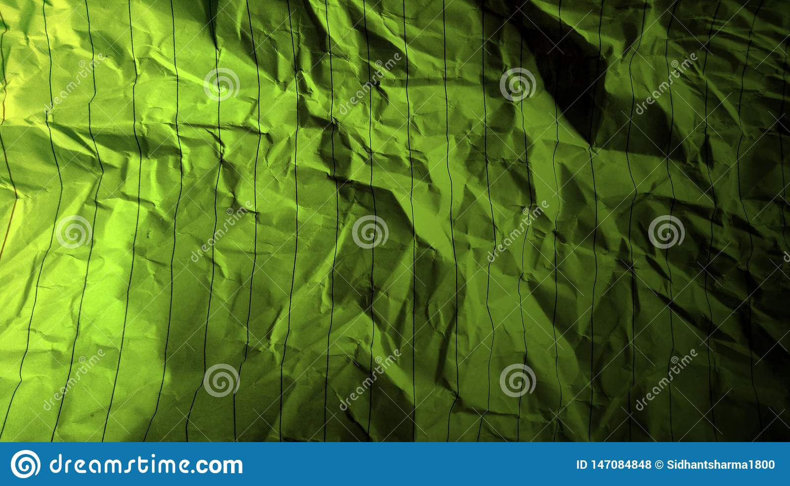 Abstract crumpled paper black martian green color mixture multi colors effects background.