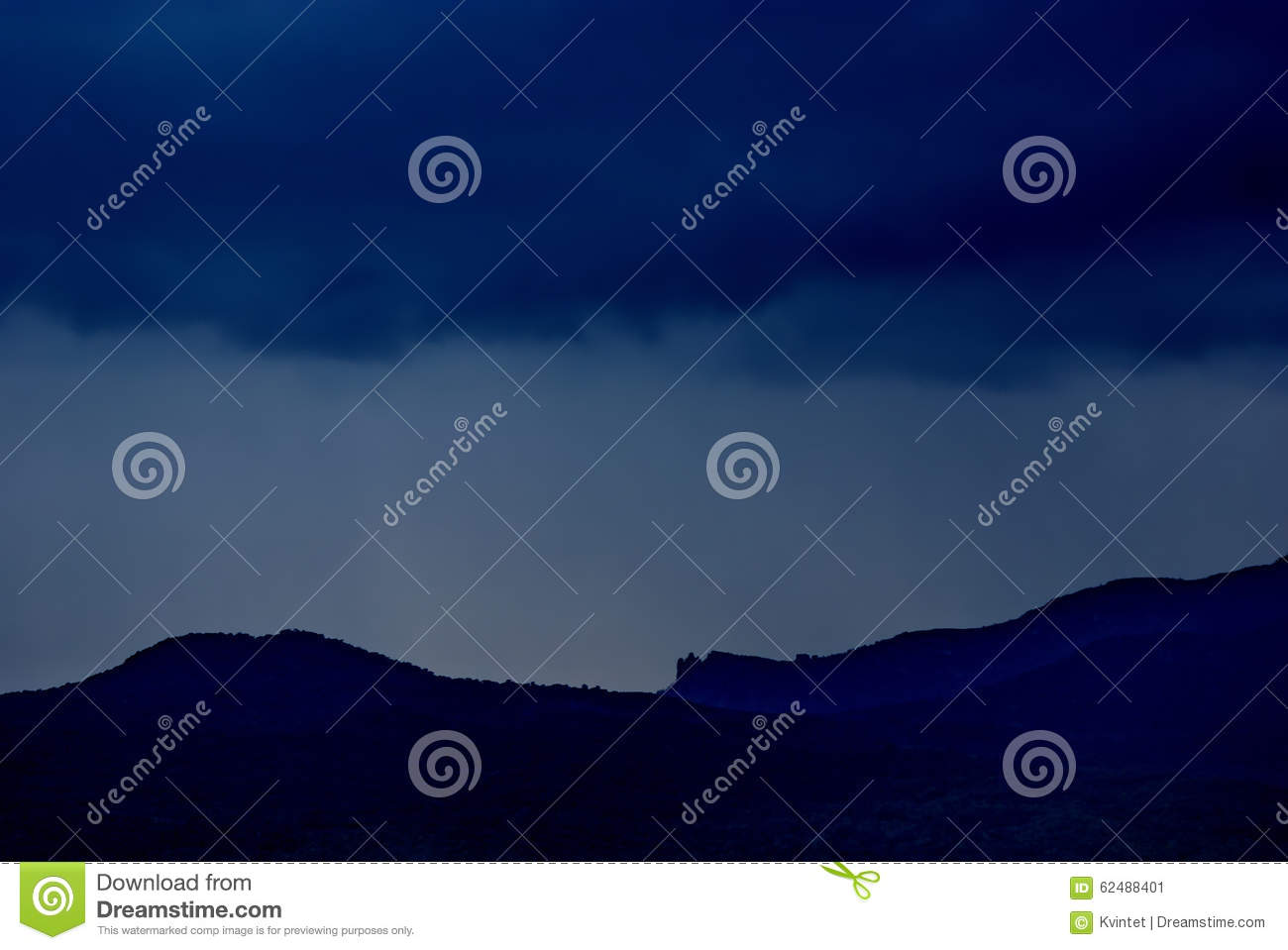 Abstract dark blue background nature with a silhouette of the mountains and the rain clouds