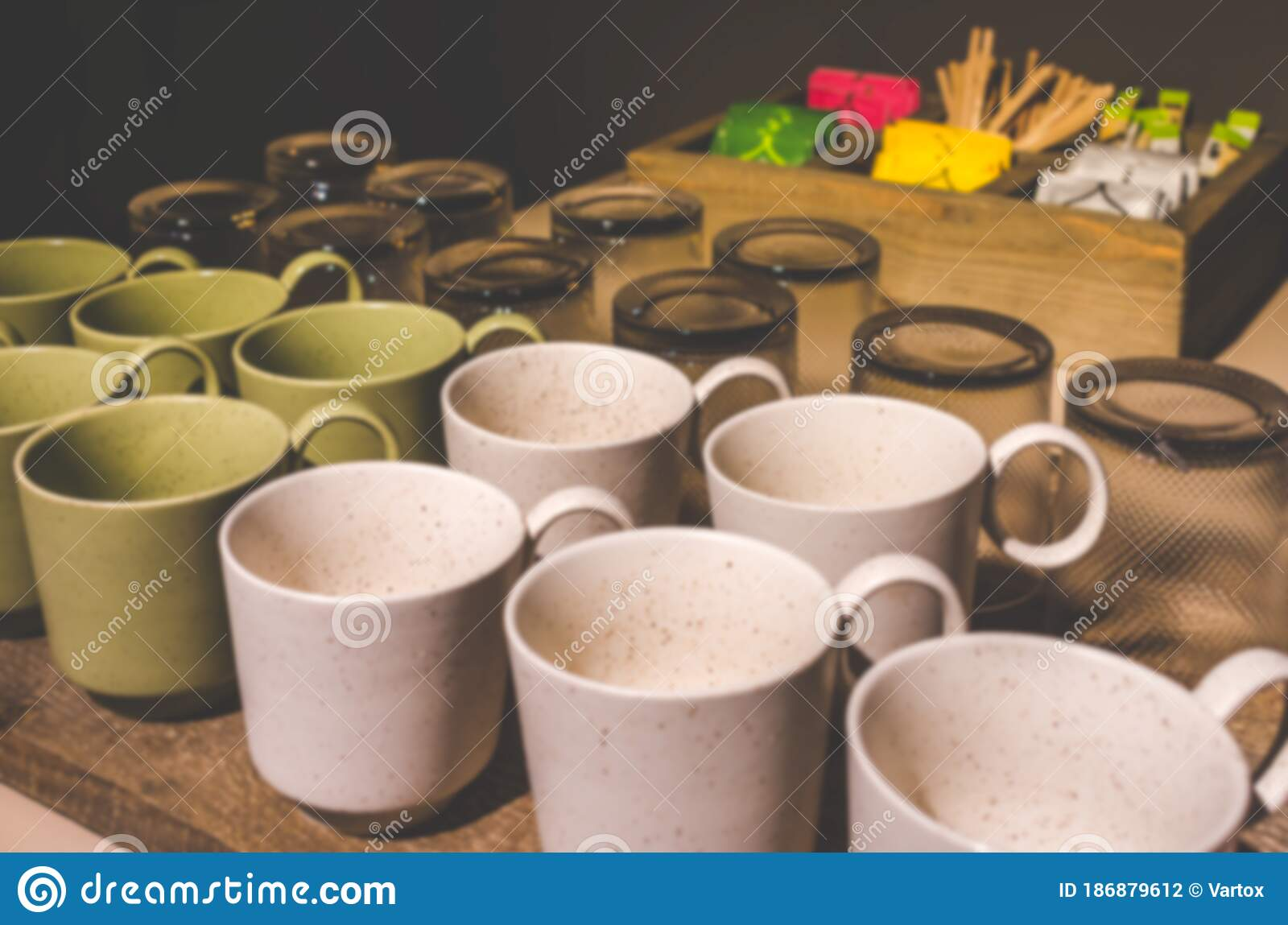 Abstract Defocused And Blurred Tea Cups And Glass For Background