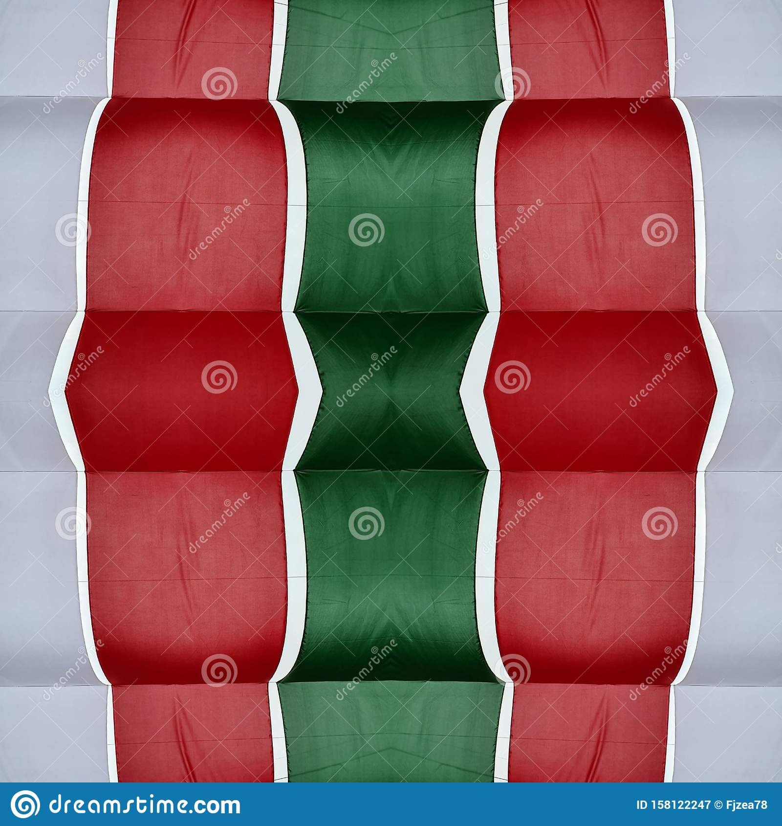 abstract design with cuts of fabric in green, white and red color, background and texture