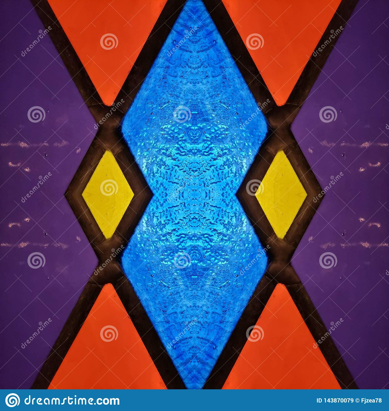 abstract design with stained glass in red, purple, blue and yellow, material for decoration of windows, background and texture