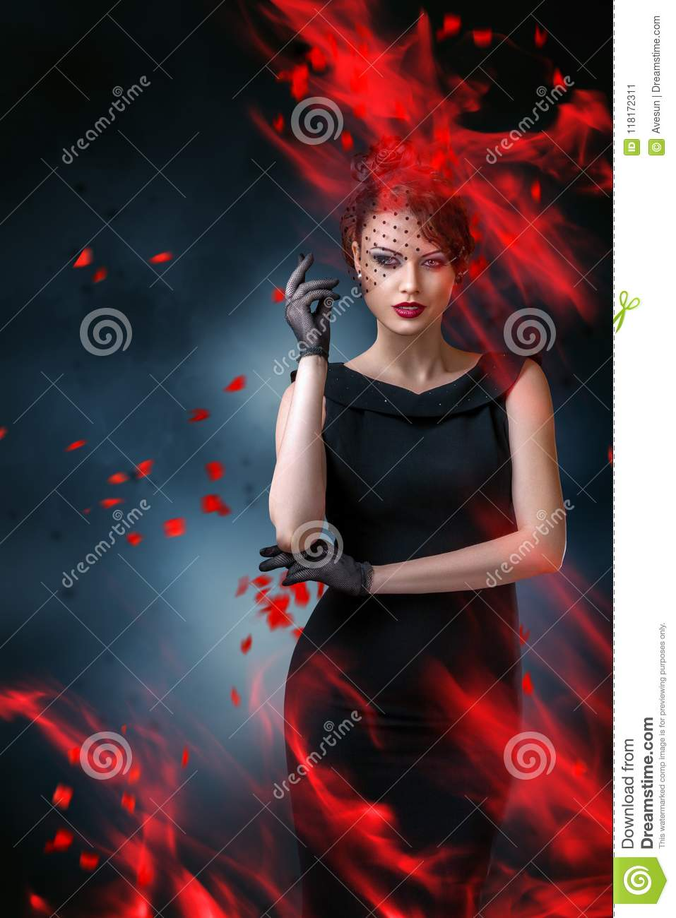 Abstract fashion portrait of young woman with flame