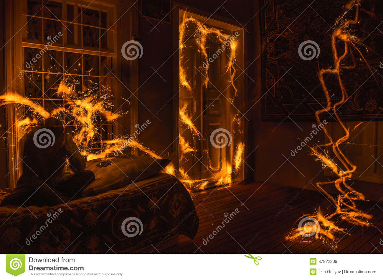 Abstract fireworks flame freezelight on window. Apartment building on Fire at Night time. Fire concept. Azerbaijan
