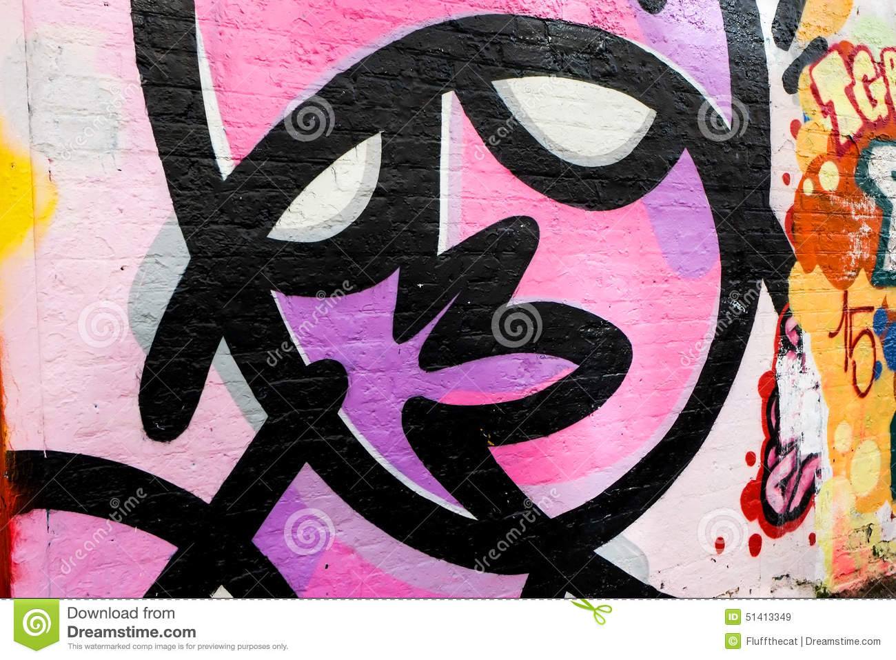 Graffiti wall art simple face design in black lines and magenta and pink paintlondon uk