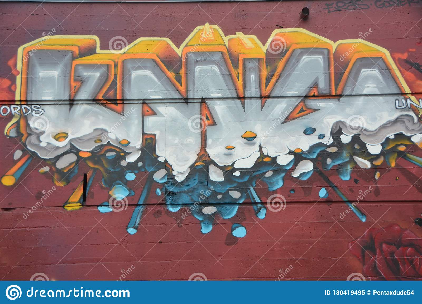 Abstract graffiti on red wall in Portland, Oregon