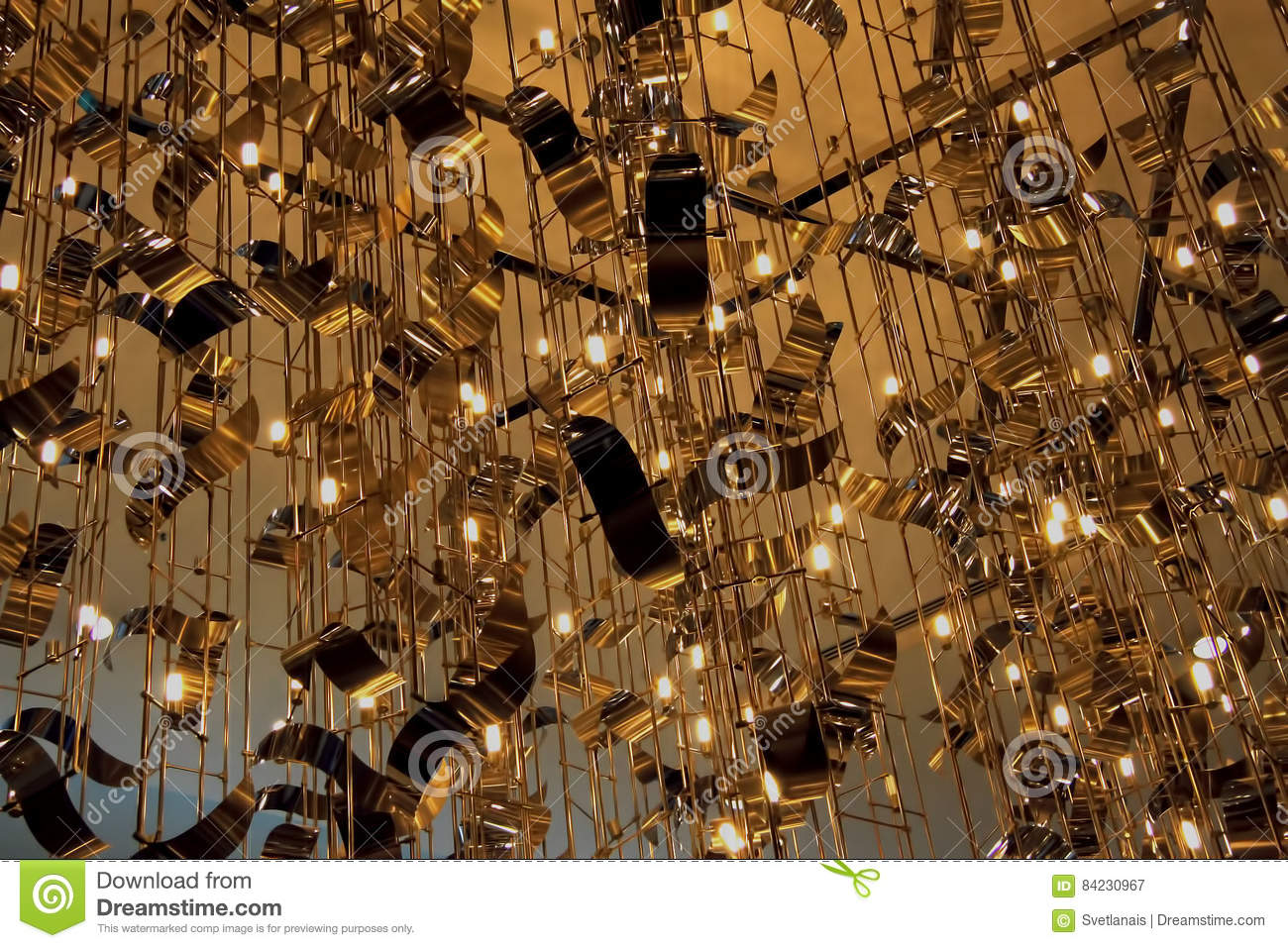 Abstract hanging on the ceiling and swaying randomly distributed metal shapes, lines with neon lights. Concept Business