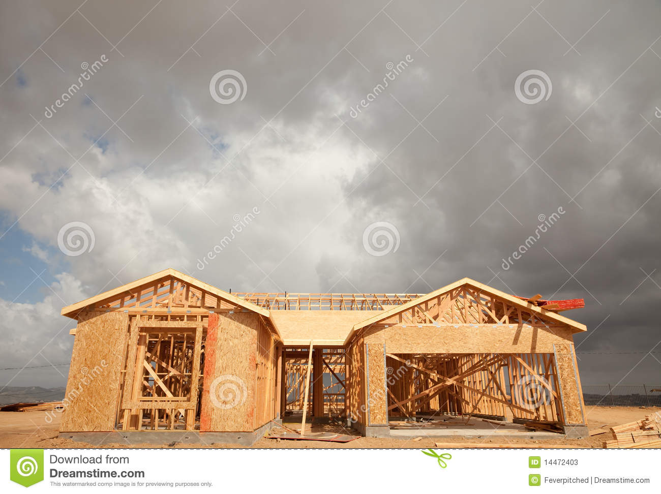 Abstract Home Construction Site and Ominous Clouds