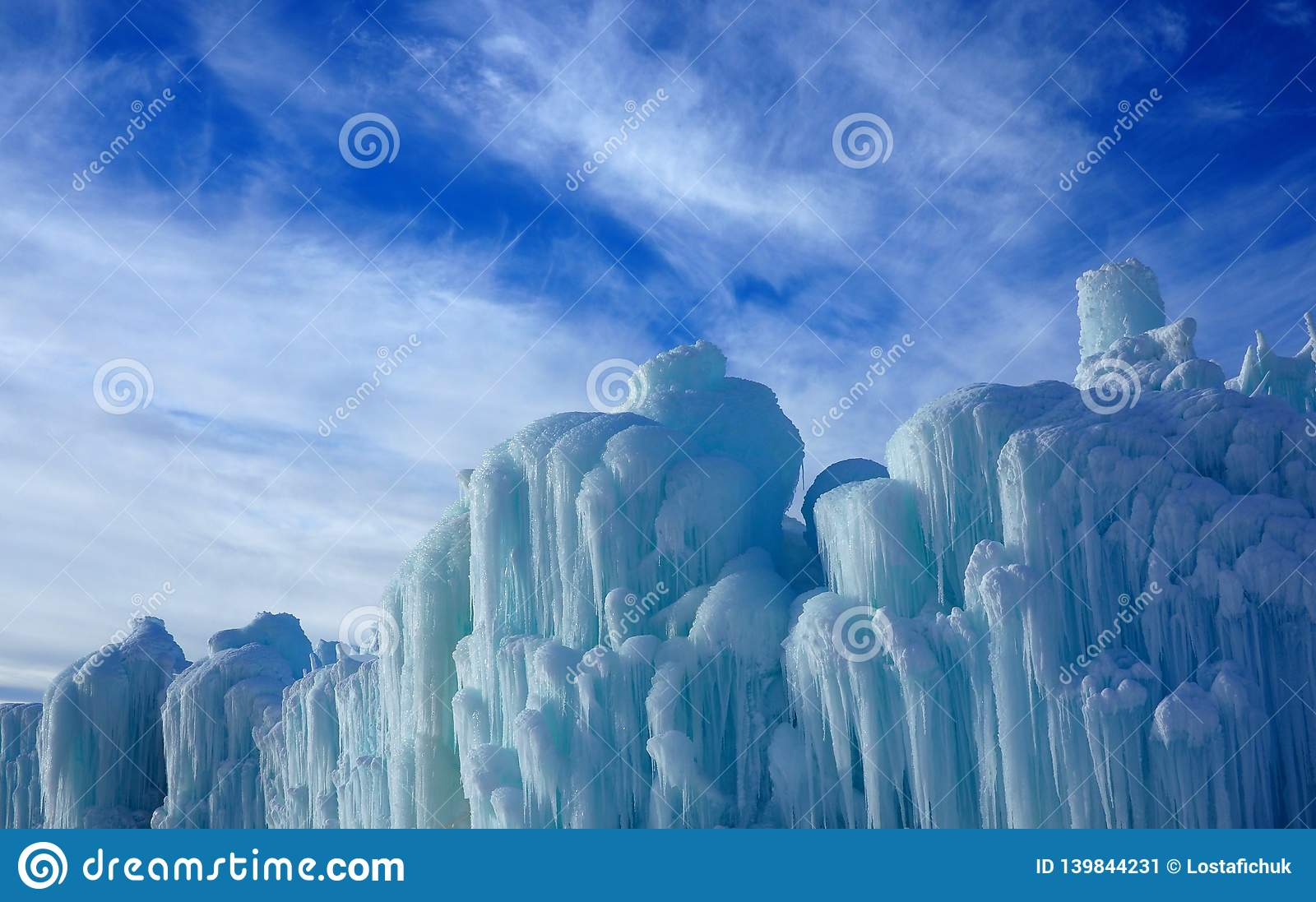 Abstract Ice Sculptures Against A Partially Cloudy Sky