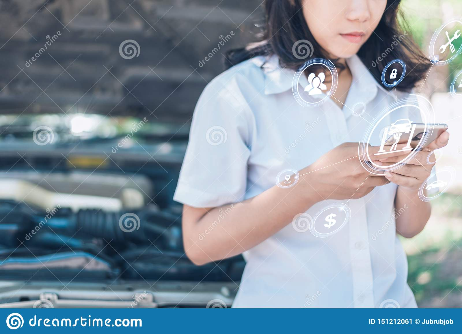 The abstract image of business man point to the hologram on his smartphone and blurred car engine room is backdrop. the concept of