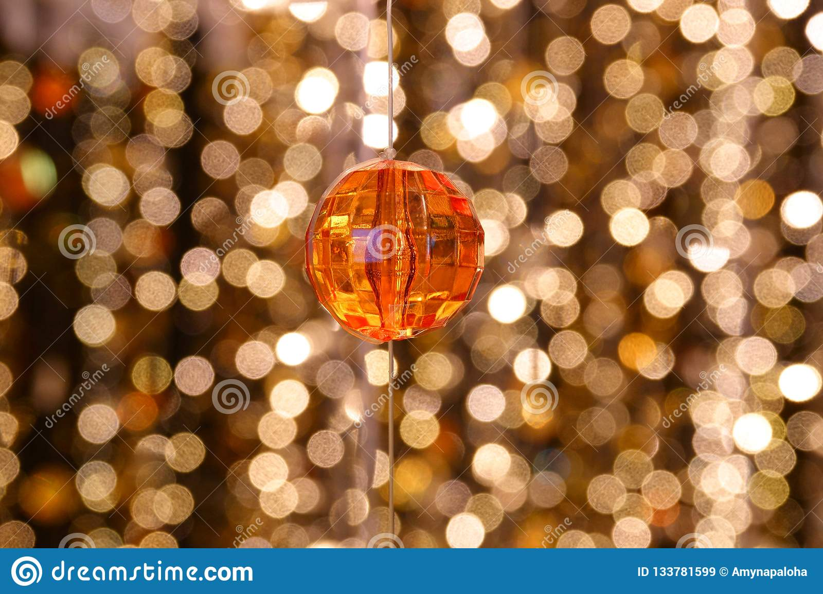 Abstract image Diamond decoration of the lines of crystal chandelier on gold light bokeh