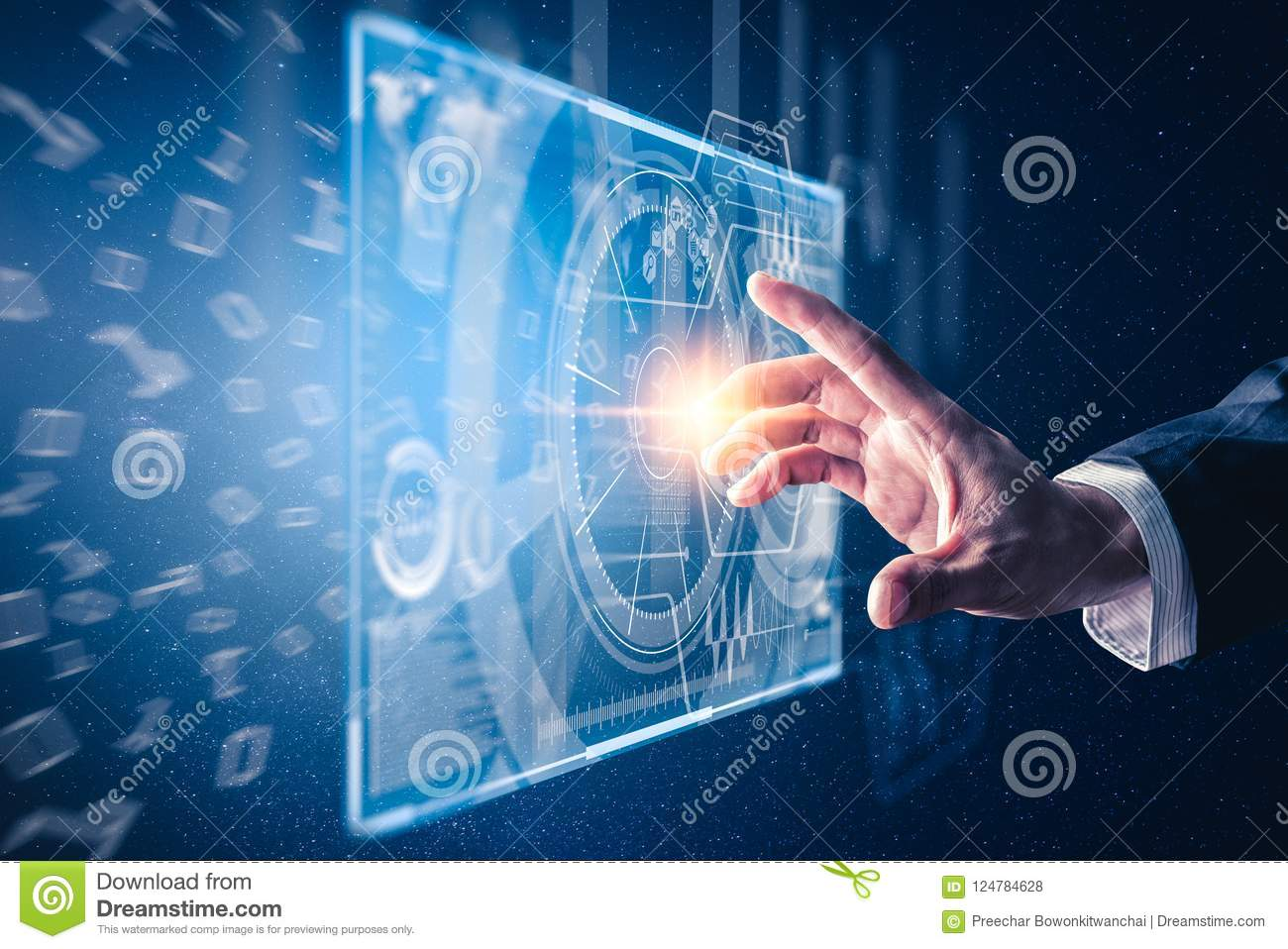 The abstract image of the hand point to the business virtual hologram through the computer screen.