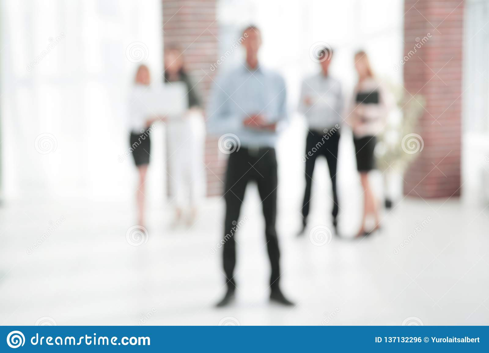 Abstract image of people in the lobby of a modern business center
