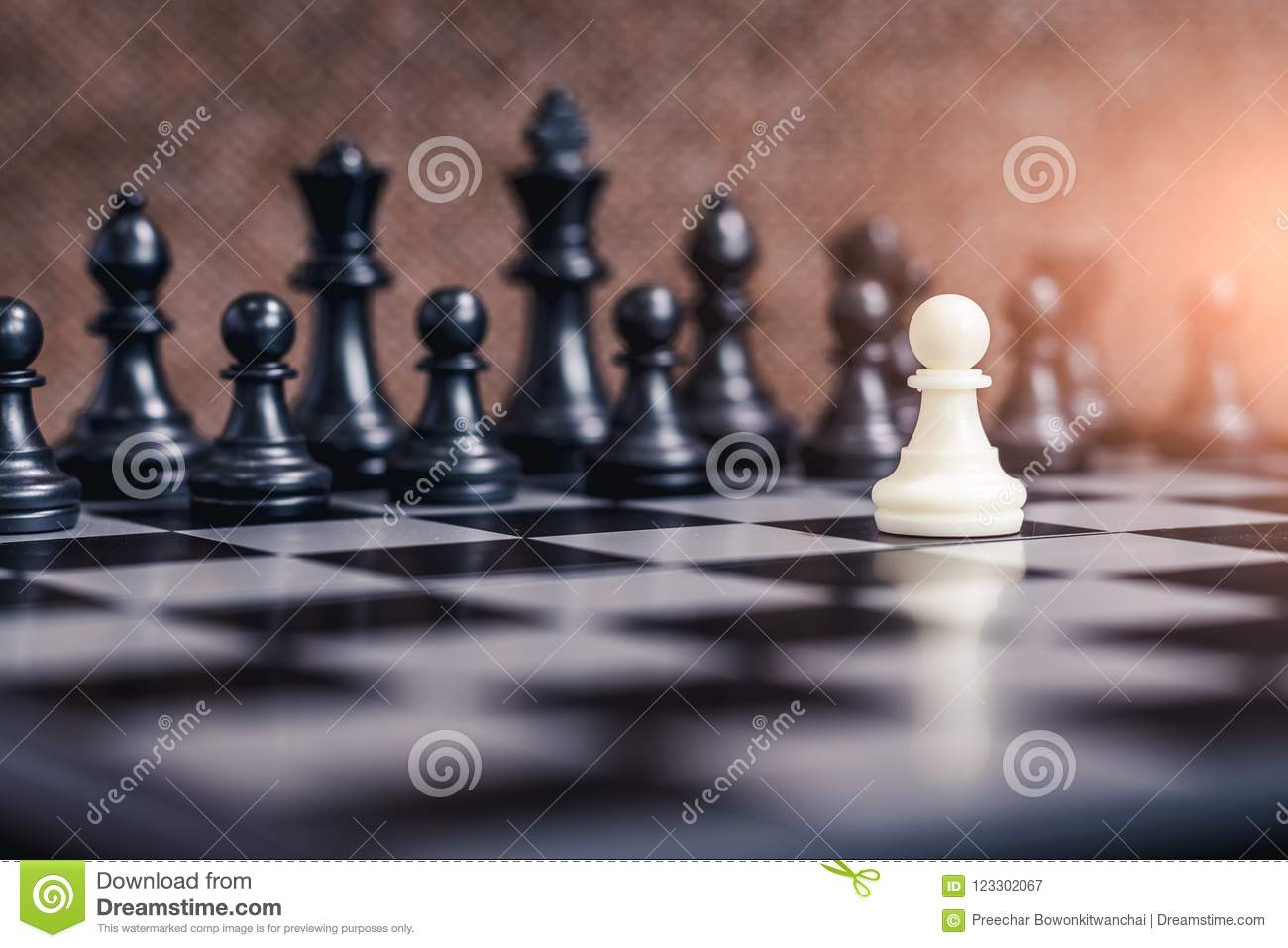 The abstract image of the white chessman face to face on the chess board.
