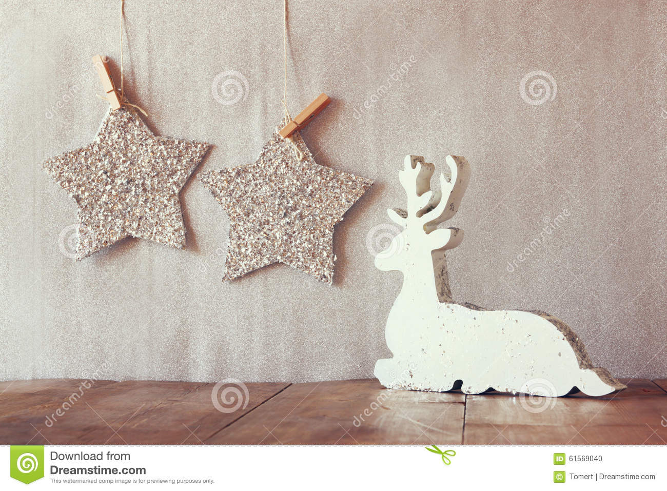 Abstract Image Of White Wooden Reindeer And Glitter Stars Hanging On
