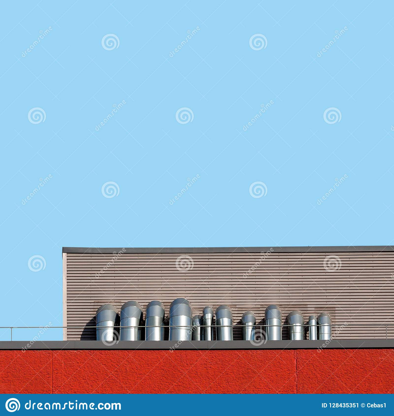 Abstract industrial architecture with roof and metal pipes