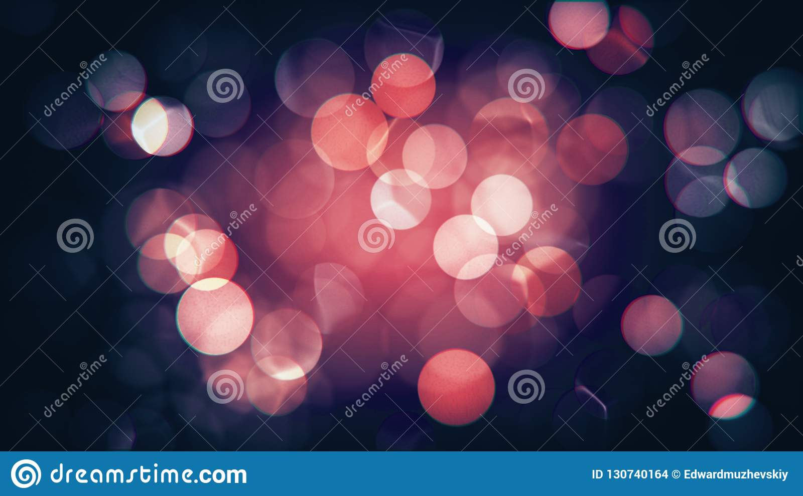 Abstract isolated blurred festive red and pink Christmas lights with bokeh