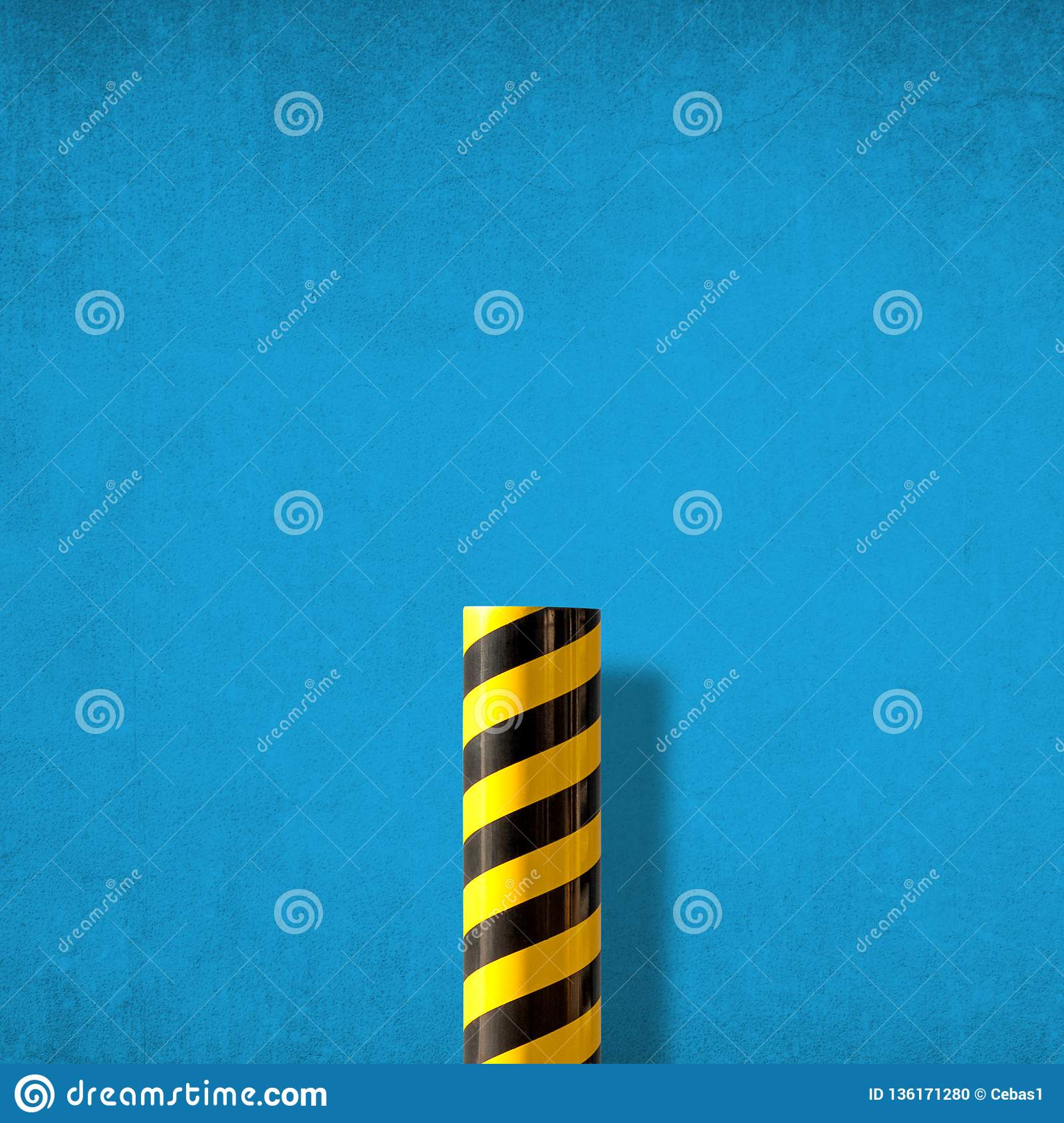 Abstract minimalist picture of road caution sign against blue wall