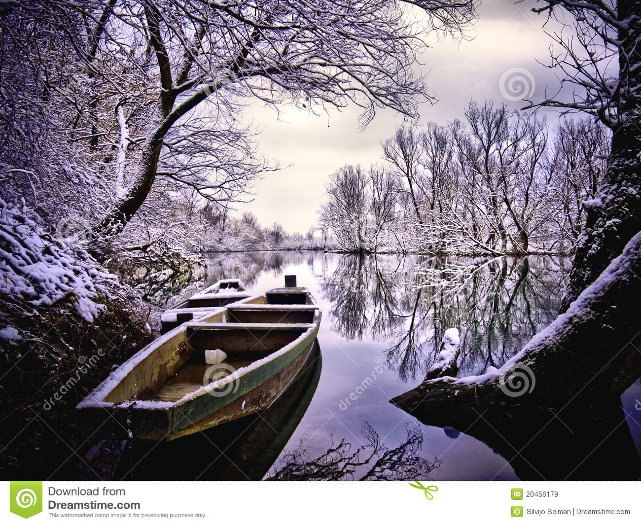 Boat and river covered with snow