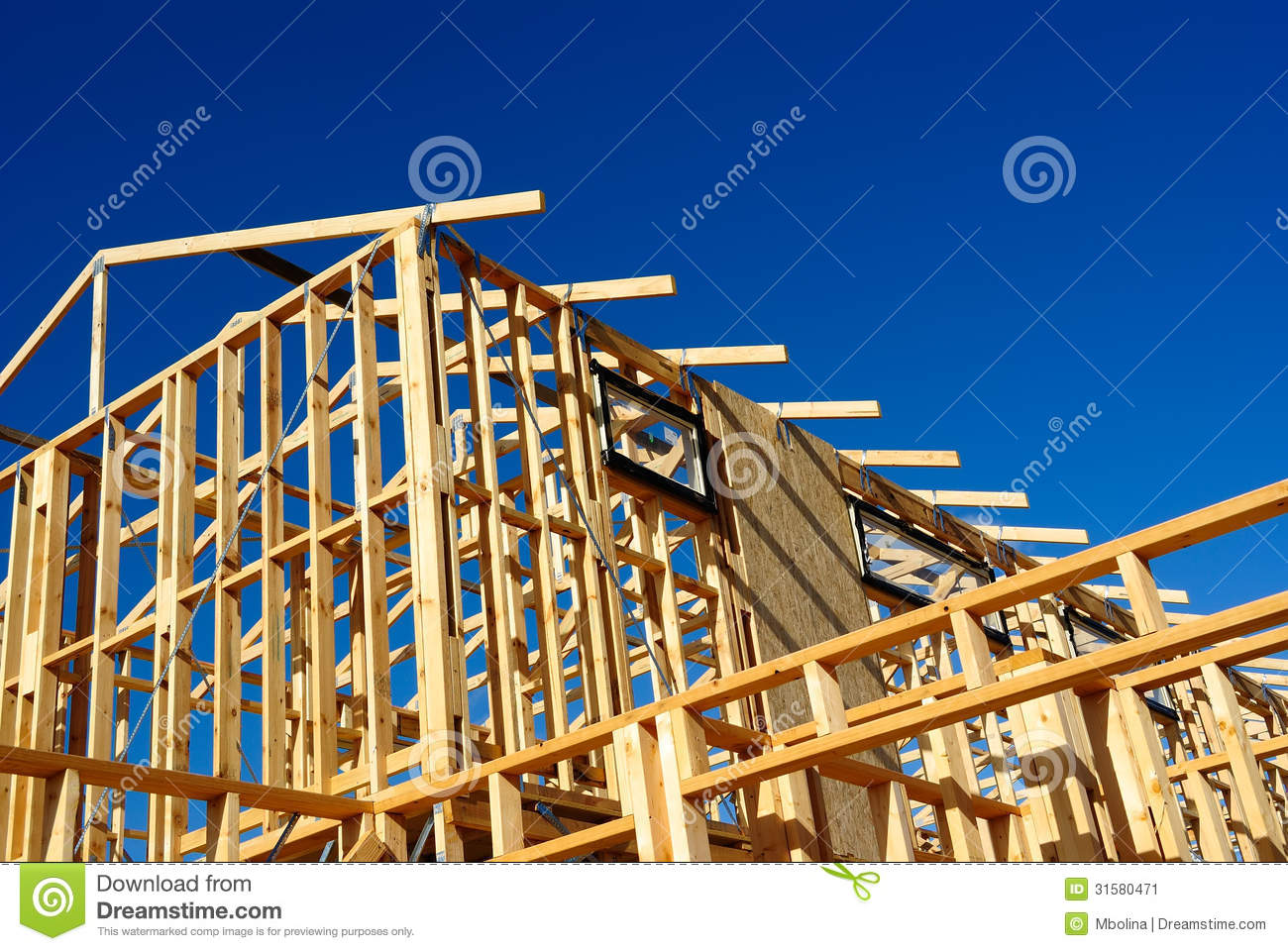 Abstract of new home construction site framing stock image for Home construction websites