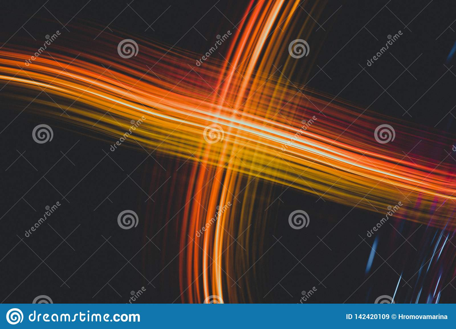 Abstract orange light stripes on a black background, the line of energy