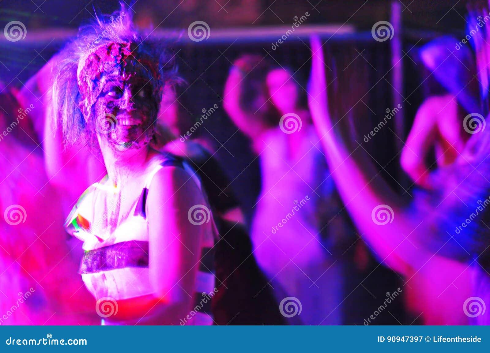 Abstract purple people dancing nightclub