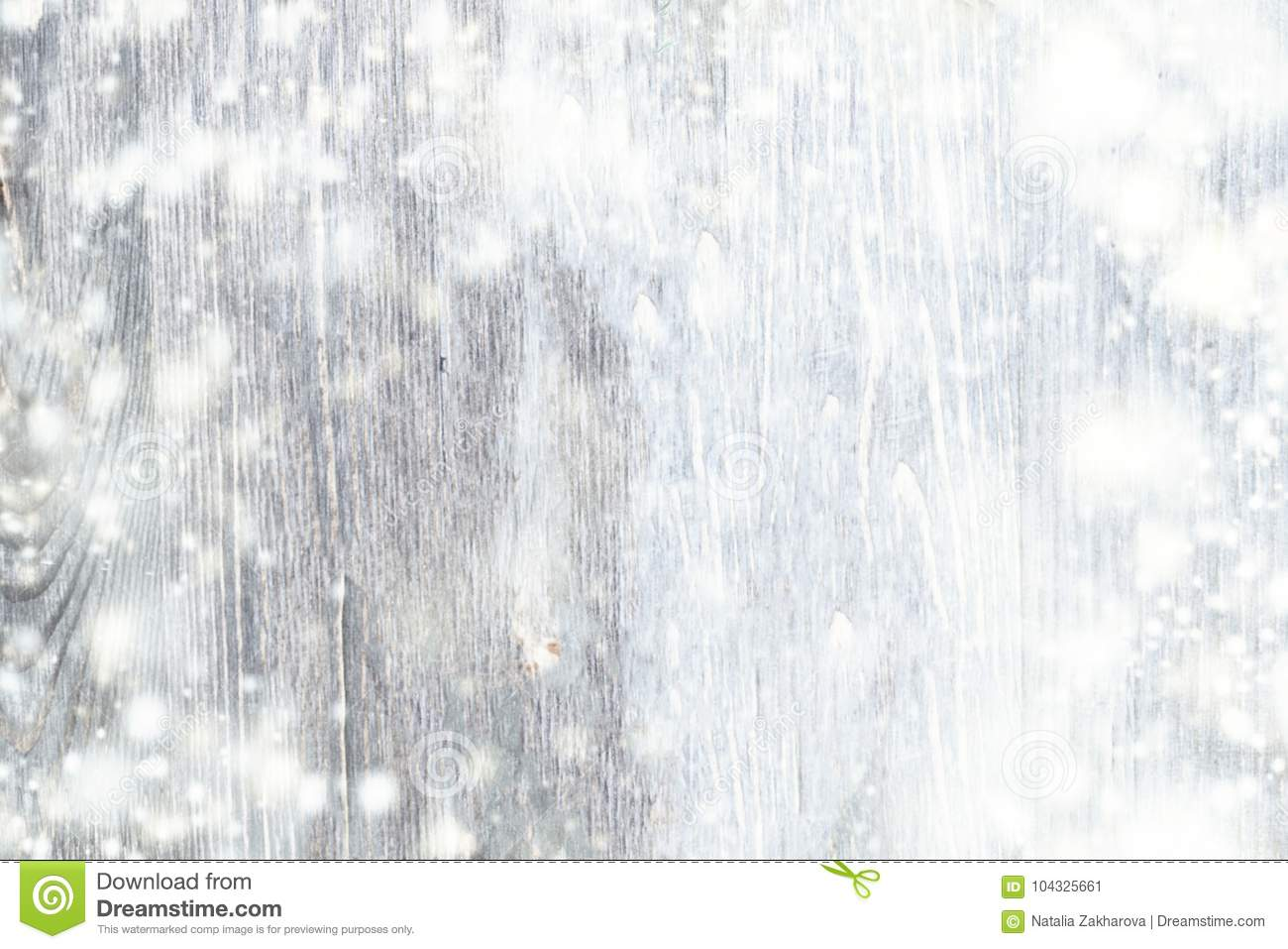 Abstract Snow Background with wooden texture and falling snowflakes. Christmas Card with copy space.